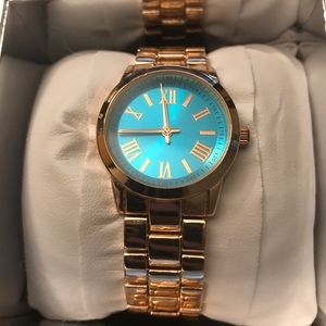 Jewelry - Beautiful rose gold watch with blue face
